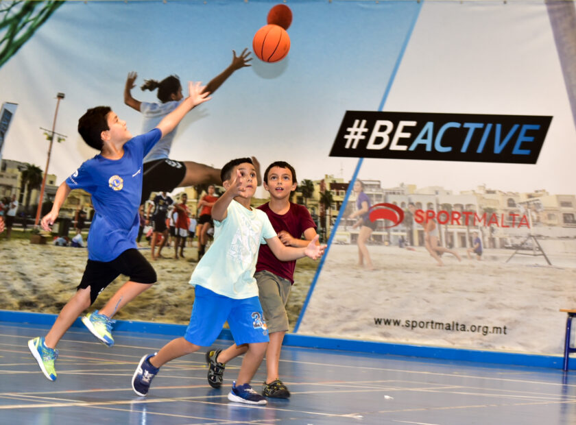Boys playing basketball at Cottonera sports complex