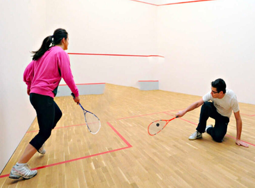Young players playing squash