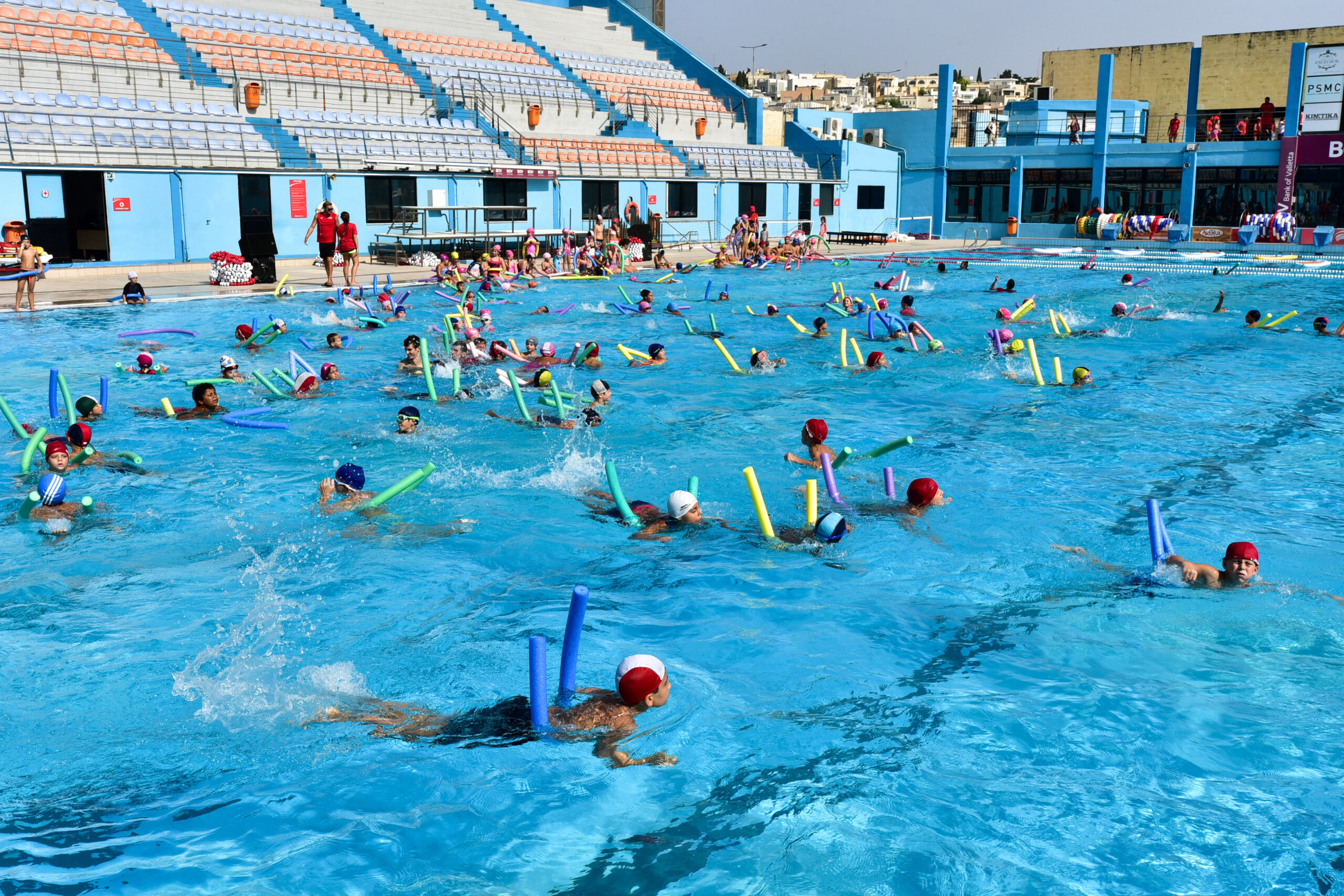 Children swimming activity at the National Pool Complex