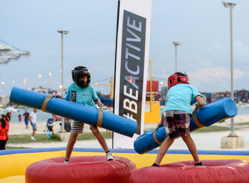 Two children wrestling in Birżebbuga during a Be Active sports event